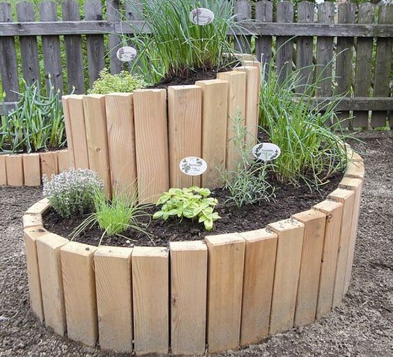 20 unique fun raised garden bed ideas for Circular raised garden bed ideas