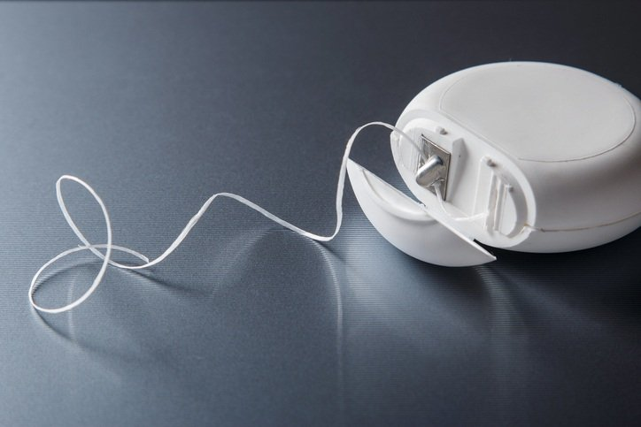7 Reasons To Floss That Go Way Beyond Dental Health